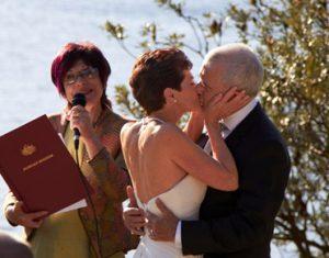 vivien reed celebrant announces wedding kiss